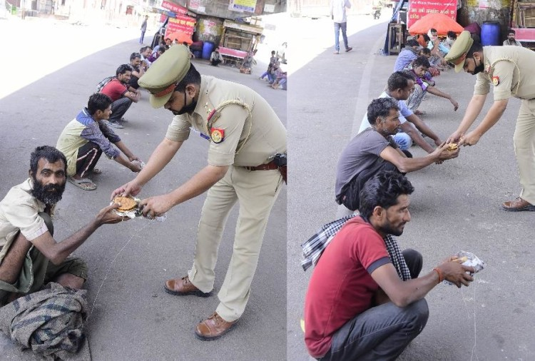 Police is helping poor people in Lucknow.