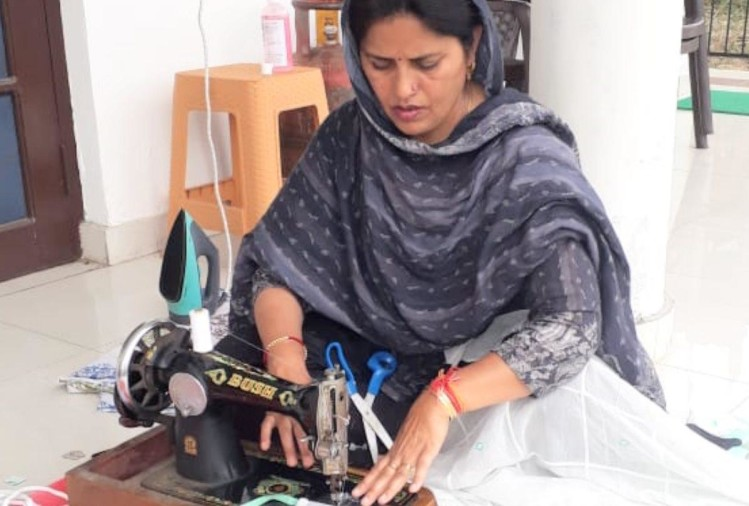 BJP MLA Kamlesh Kumari making masks with sewing machine at home in Bhoranj in Hamirpur in Himachal Pradesh